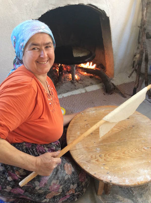 Fatma Mete of Sidyma Homes cooking something delicious.